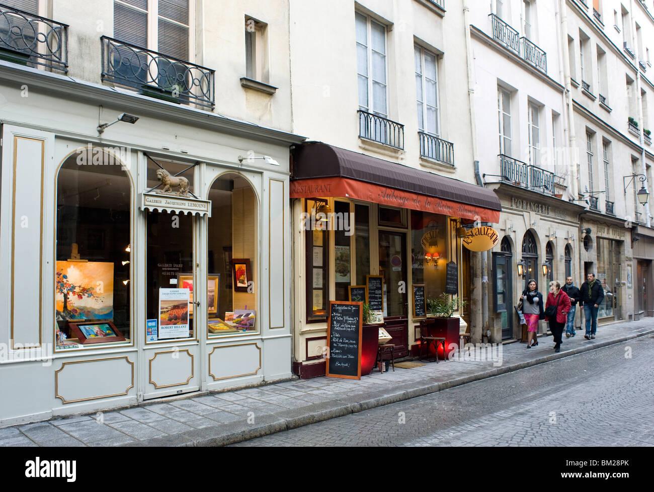 Shops and restaurants on the Ile St. Louis, Paris, France - Stock Image