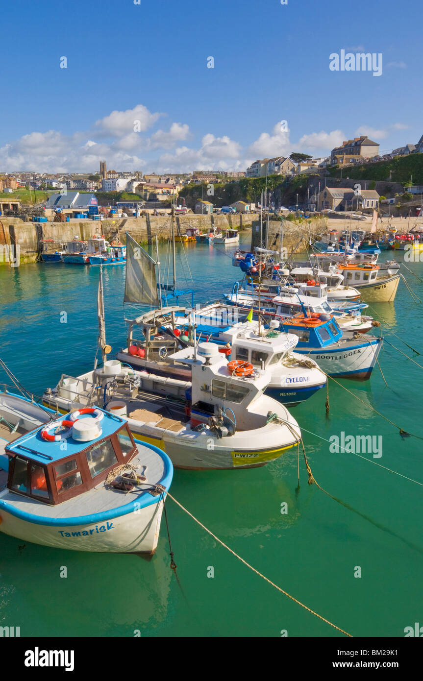 Small fishing boats in the harbour at high tide, Newquay, North Cornwall, UK - Stock Image