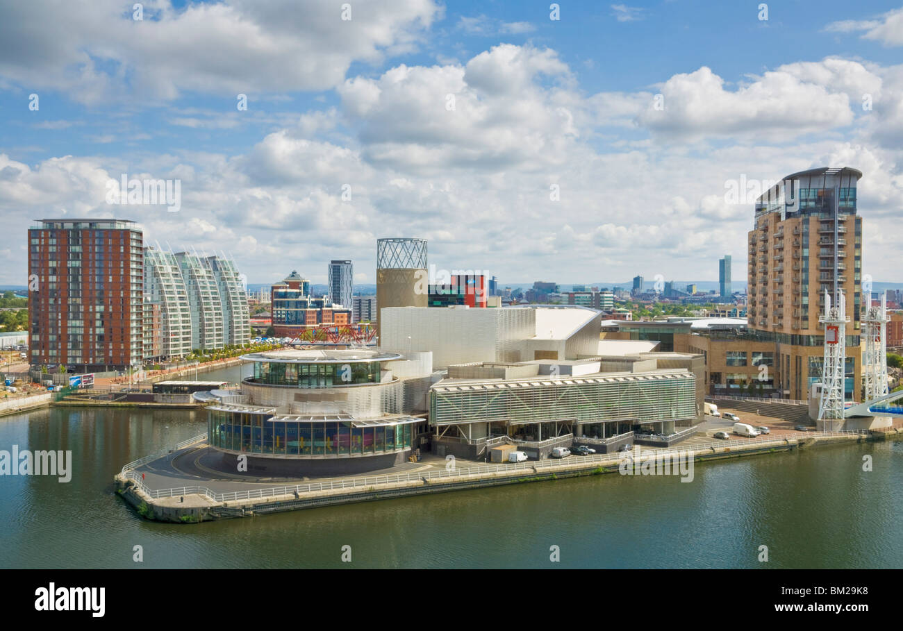View across the Lowry Centre, apartments and new building construction work at Salford Quays Pier 8, Manchester, - Stock Image