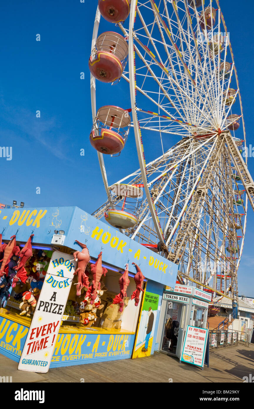 Big wheel and prize stall on the Central Pier, Blackpool, Lancashire, UK - Stock Image