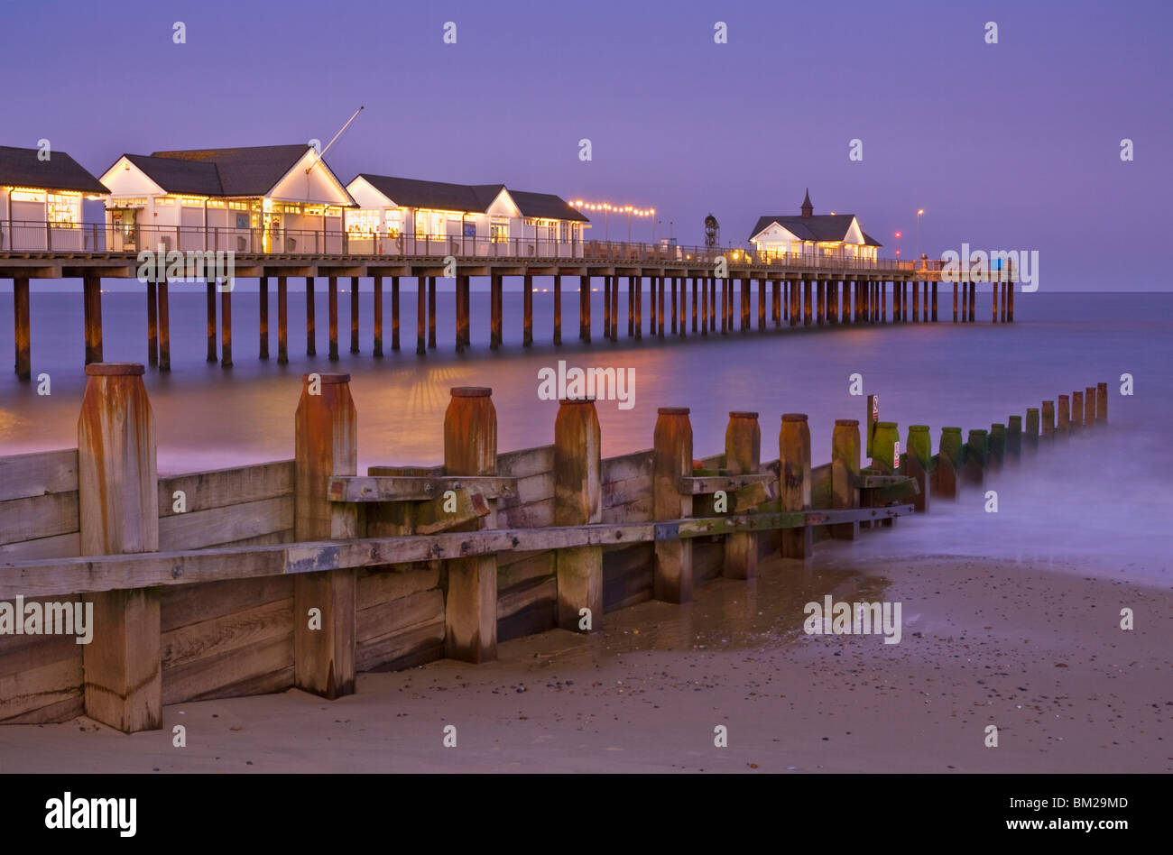 Southwold pier and wooden groyne at sunset, Southwold, Suffolk, UK - Stock Image