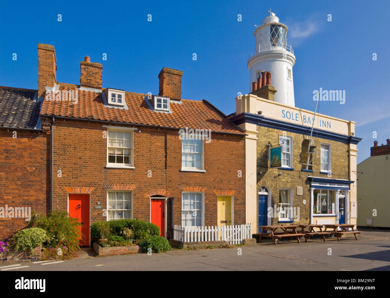 The Sole Bay Inn pub with Southwold lighthouse behind, Southwold, Suffolk, UK - Stock Image
