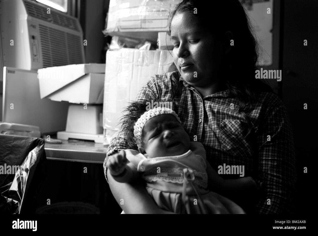 An HIV positive mother and her baby, who is HIV negative in Roatan Honduras. - Stock Image
