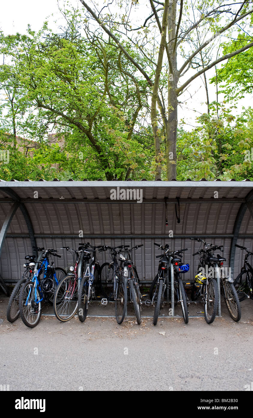 Commuters bicycles parked in a shelter in Chelmsford in Essex.  Photo by Gordon Scammell - Stock Image