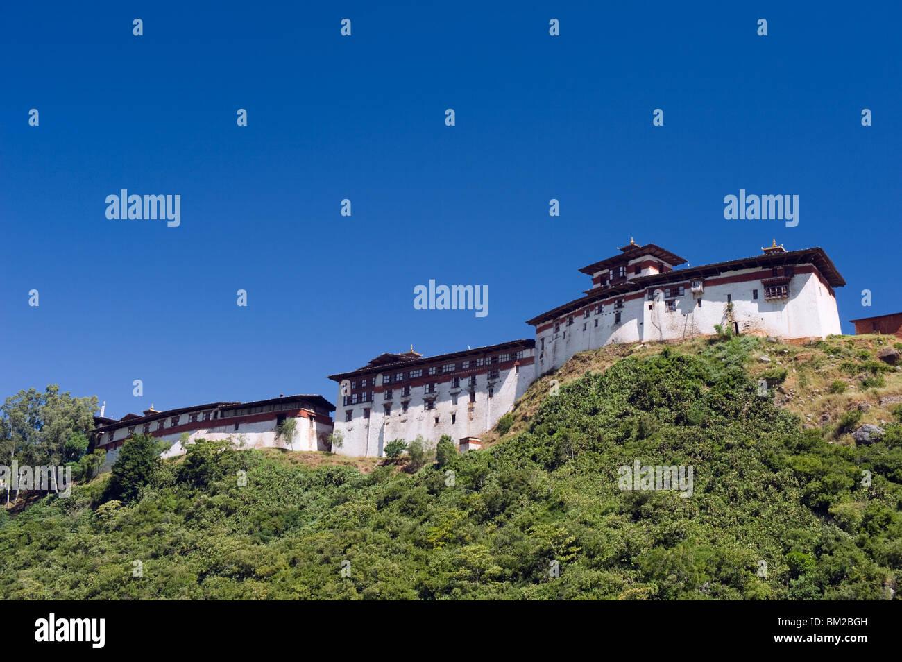 Ridge top Wangdue Phodrang Dzong, founded by the Zhabdrung in 1638, Bhutan - Stock Image