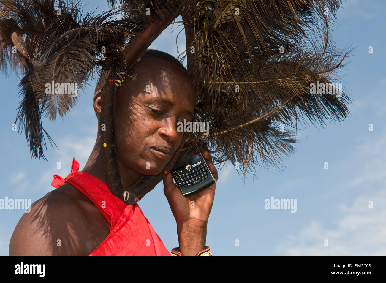 Masai man talking on mobile phone, Masai Mara, Kenya, East Africa - Stock Image