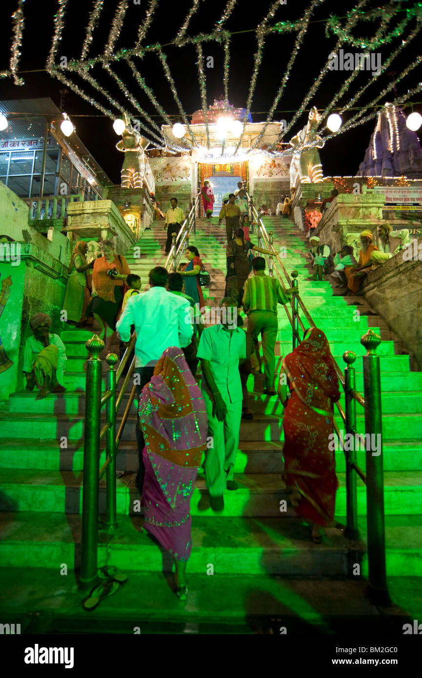 Entrance to Jagdish temple lit up and decorated with tinsel for Diwali festival celebrations, Udaipur, Rajasthan, - Stock Image