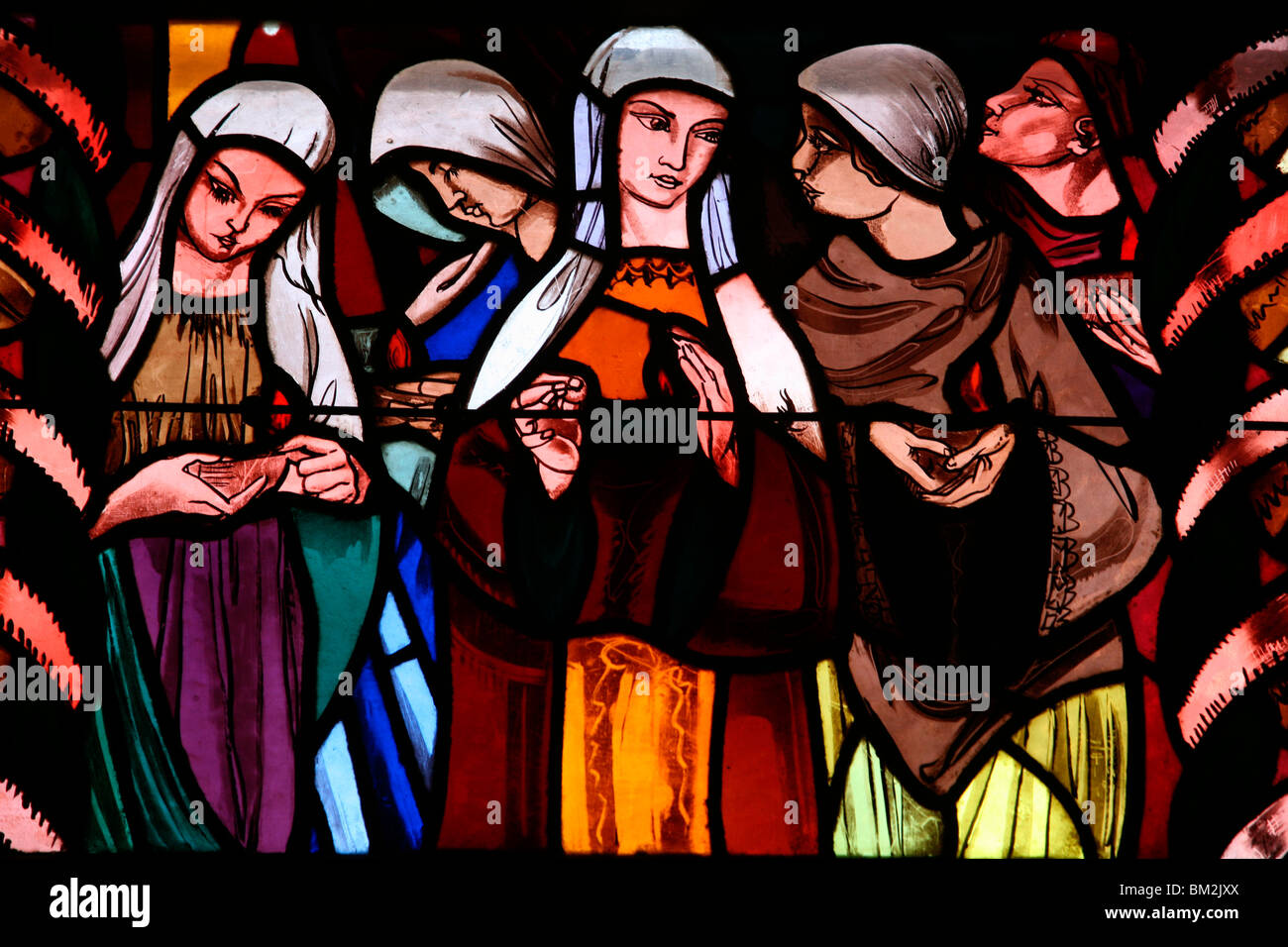 Holy virgins in the stained glass window of Saint-Joseph des Fins church, Annecy, Haute Savoie, France Stock Photo