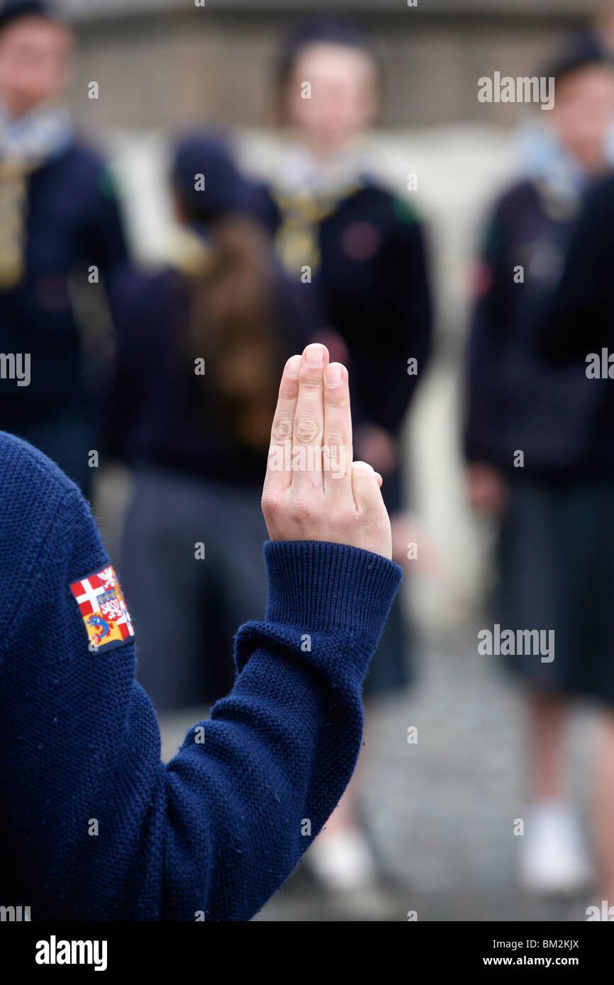 Girl scouts saluting, Rome, Lazio, Italy - Stock Image