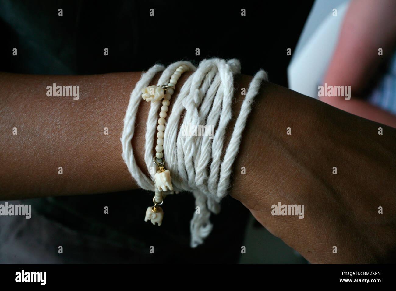 Buddhist wrist strings, Luang Prabang, Laos, Indochina, Southeast Asia - Stock Image