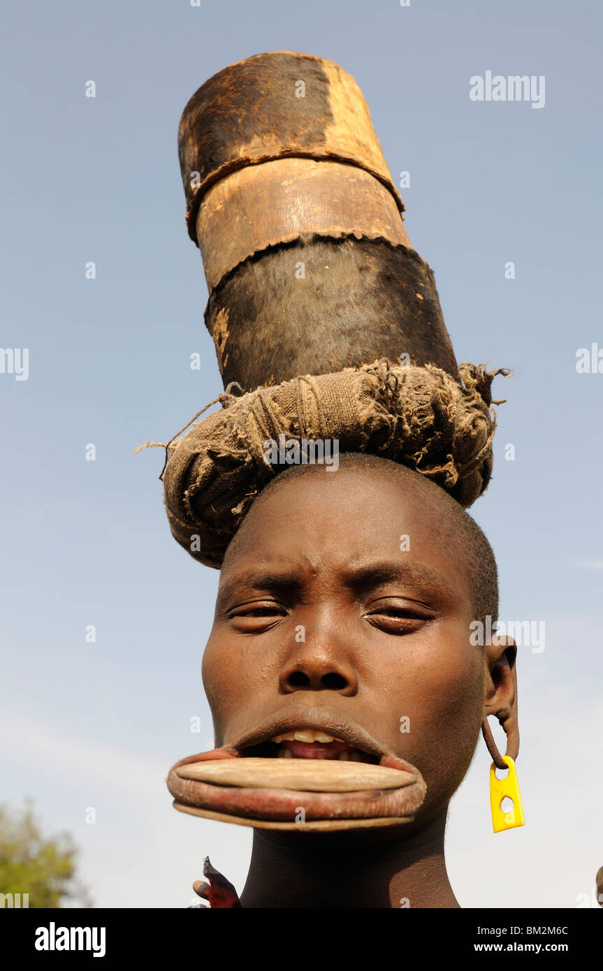 Traditional Mursi woman with lip plates, Omo Valley, Southern Ethiopia, Ethiopia - Stock Image
