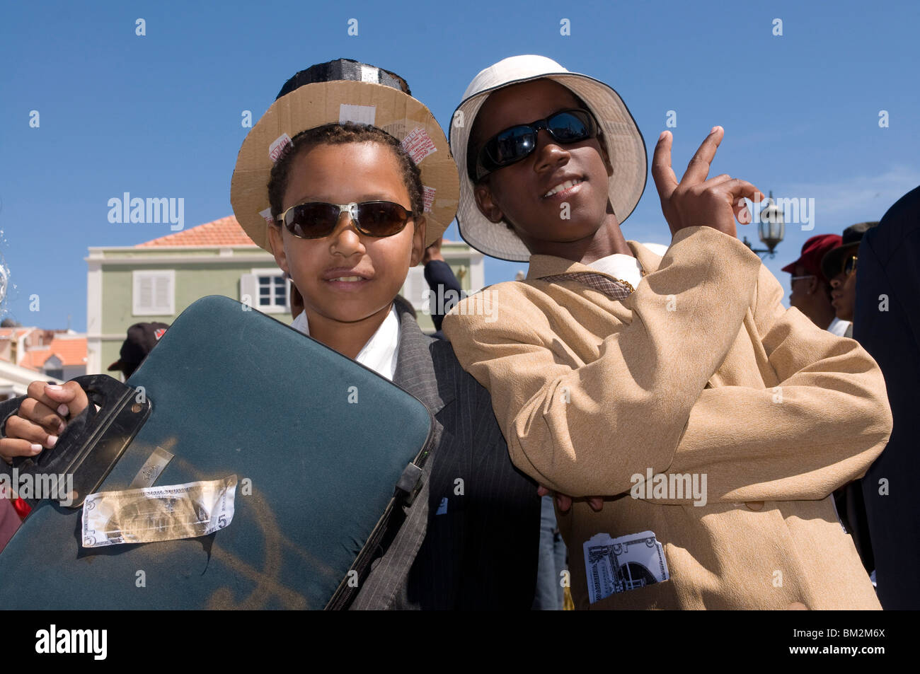 Young men dressed as businesspeople during Carnival, Mindelo, Sao Vicente, Cape Verde - Stock Image