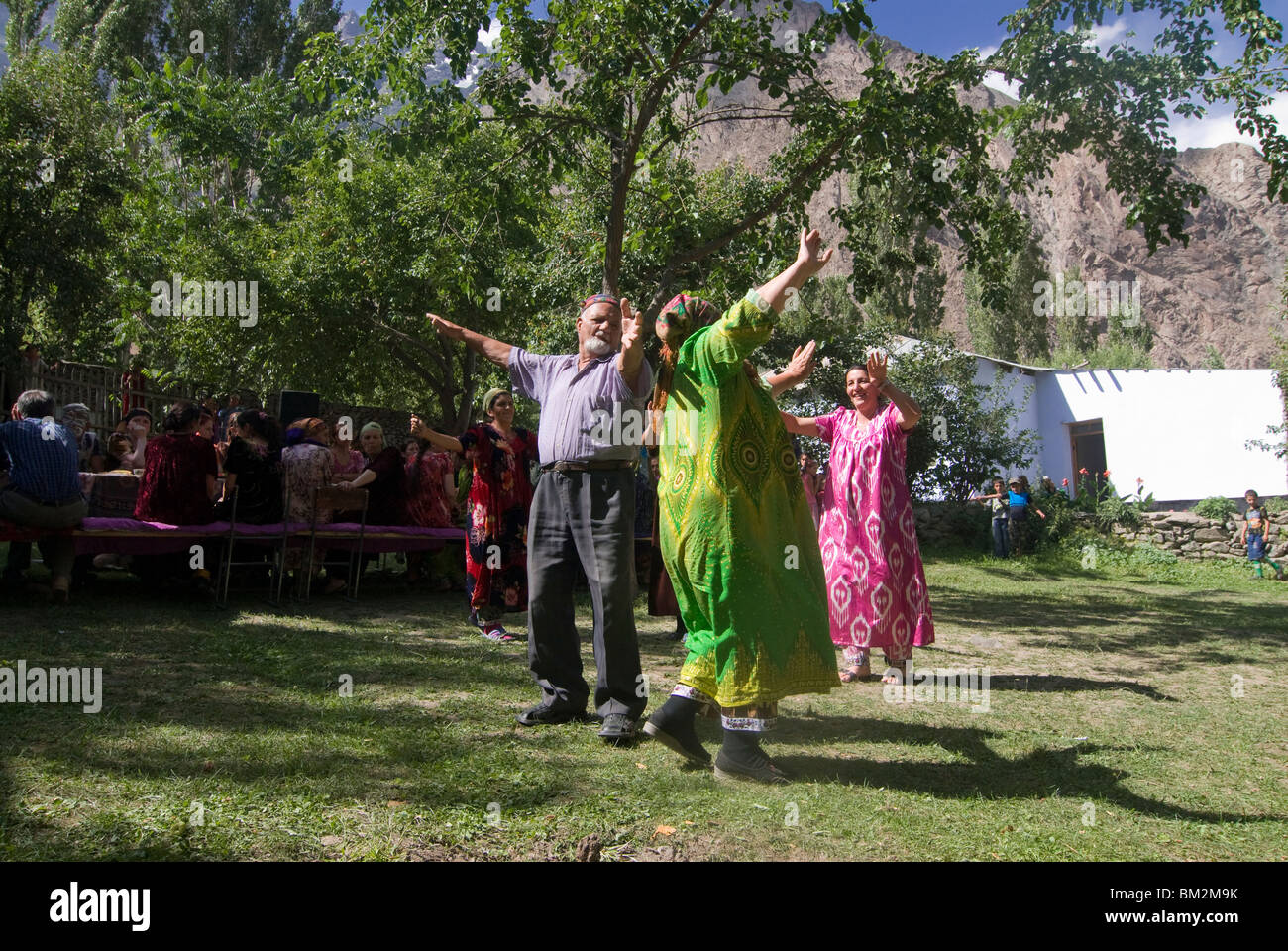 People dance at a traditional Pamiri wedding, Bartang valley, Tajikistan Stock Photo