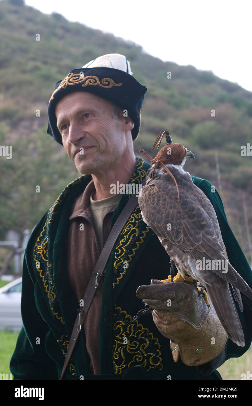 Falconer with a falcon, Sunkar Eagle Farm, Kazakhstan - Stock Image