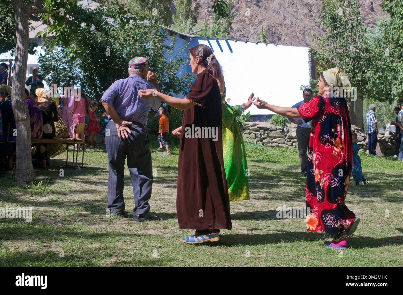 Dancing guests at wedding of Pamiris, Bartang Valley, Tajikistan - Stock Image