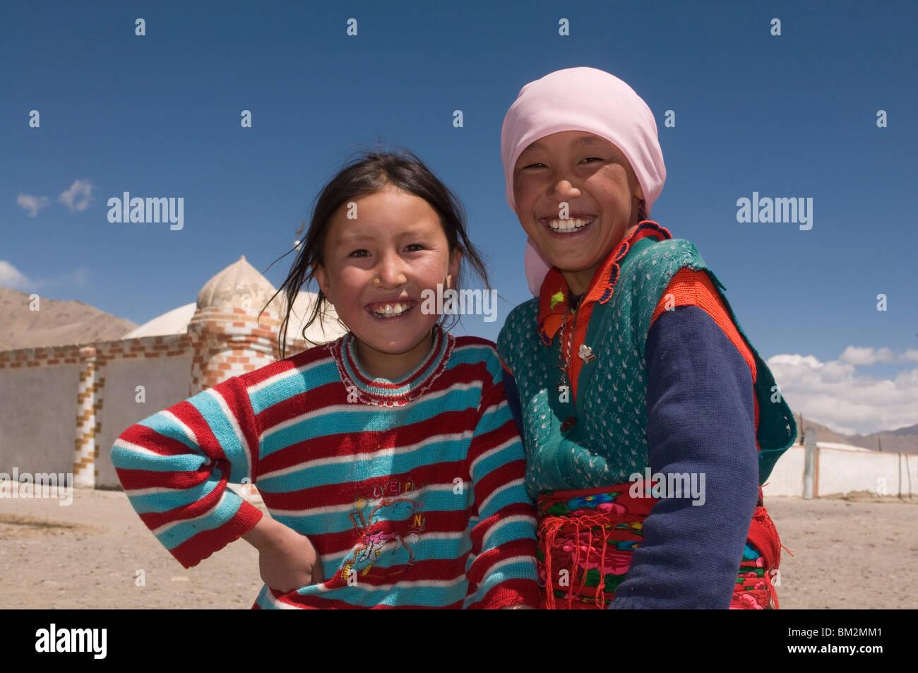 Two happy girls, Pamir Highway, Tajikistan - Stock Image