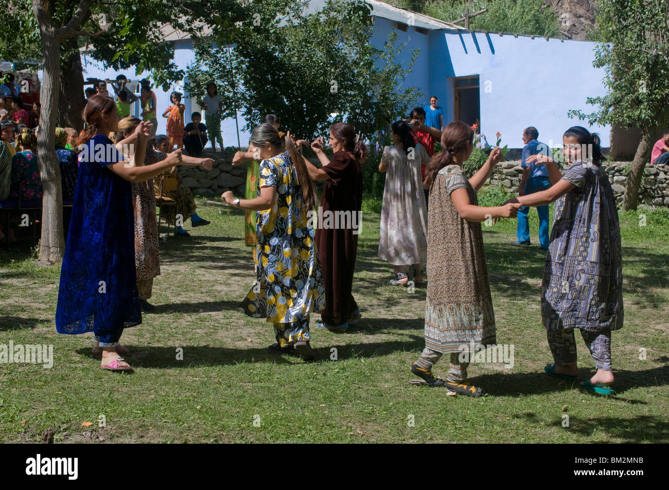 Dancing guests at wedding at Pamiris, Bartang Valley, Tajikistan - Stock Image