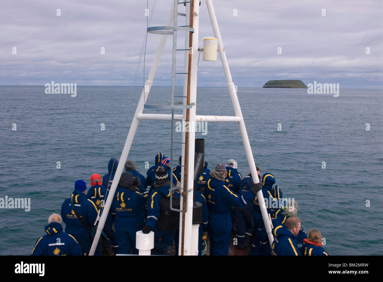 Trawler with tourists on their way to watch whales, Husavik, Iceland, Polar Regions - Stock Image