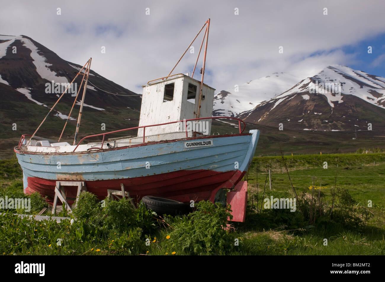 Fishing boat on land, Eyjafjordur, Iceland, Polar Regions - Stock Image