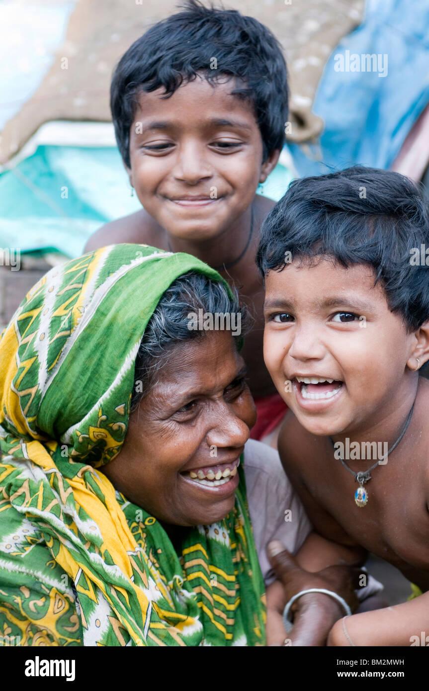 Indian familiy laughing, Kalighat, Kolkata, India - Stock Image