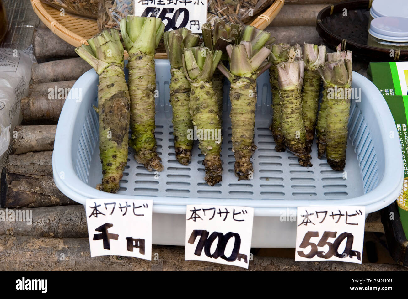 Three different sizes of raw wasabi horseradish root for sale at a market in Echizen-Ono, Fukui, Japan - Stock Image