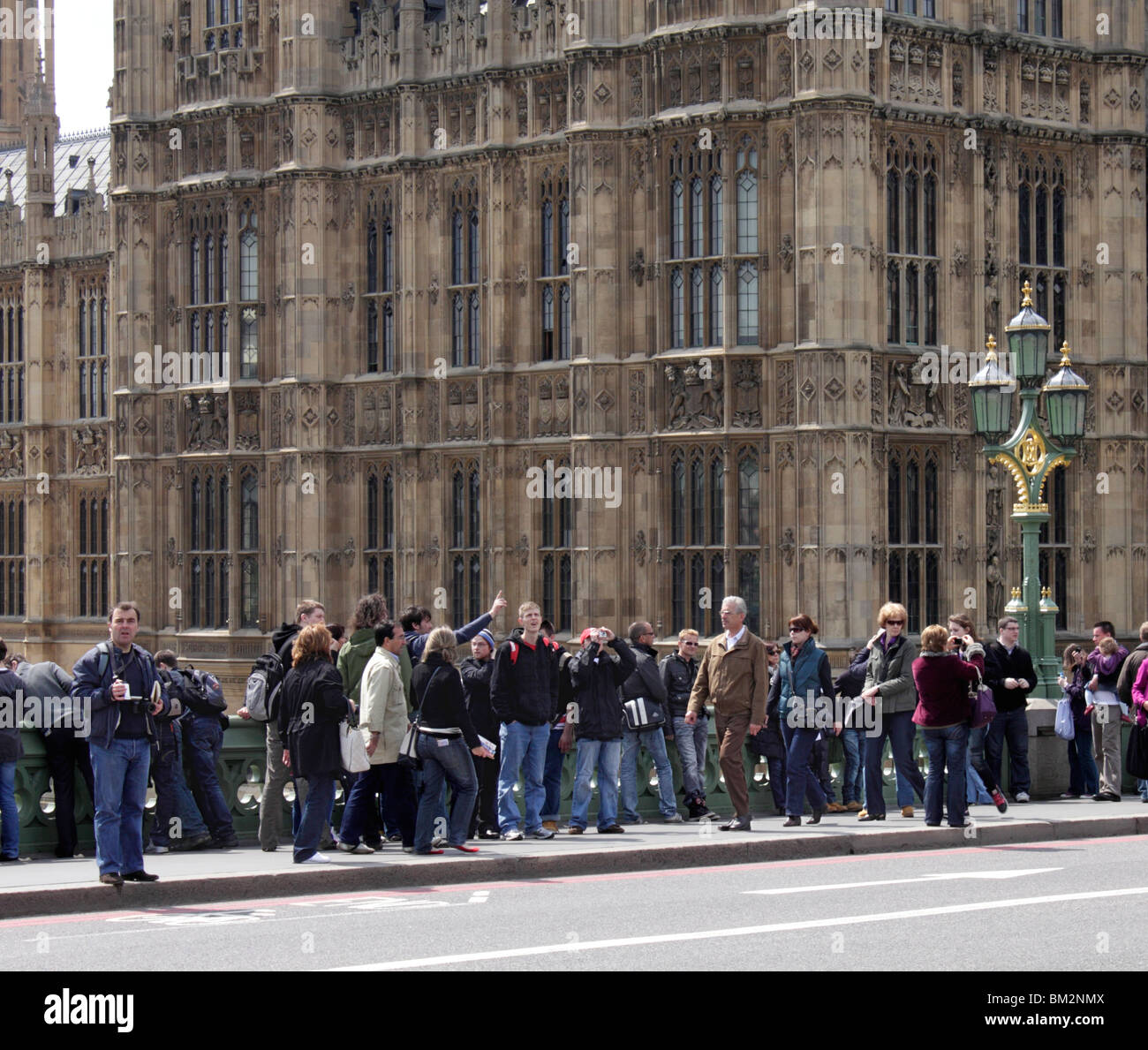 Tourists on Westminster Bridge London May 2010 Stock Photo