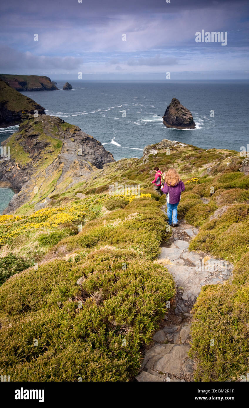 A family group hiking along the South West Coast Path near Boscastle in north Cornwall, England, UK - Stock Image