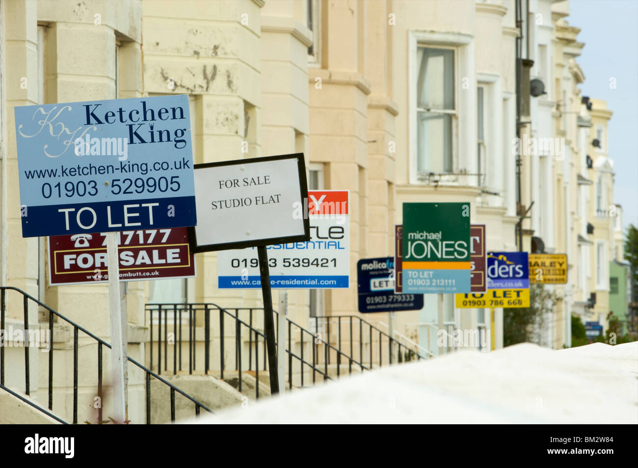For sale and To Let signs outside houses in Littlehampton - 15 May 2010 - Stock Image