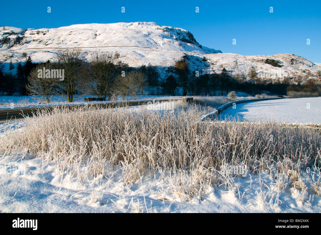 Dod Crag from Shoulthwaite Farm in winter, on the A591 road near Keswick, Lake District, Cumbria, England, UK - Stock Image