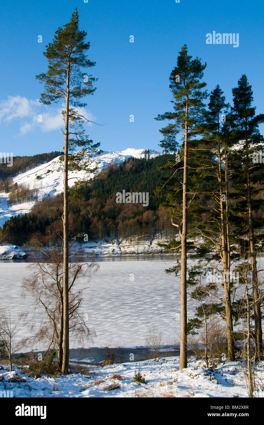 Thirlmere reservoir frozen over in winter, Lake District, Cumbria, England, UK - Stock Image