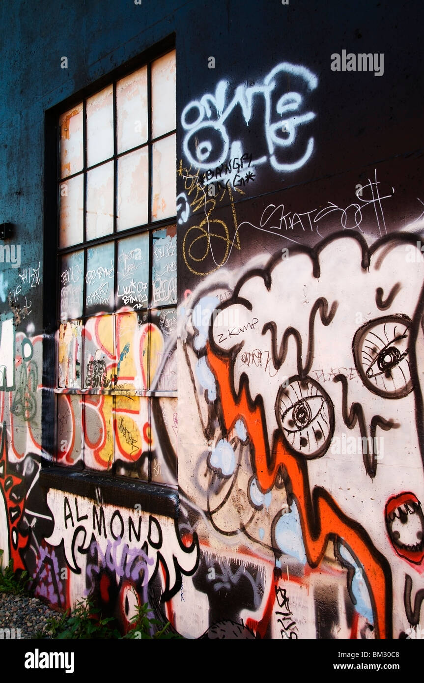 Graffiti on building exterior in alley in downtown Olympia, Washington. - Stock Image