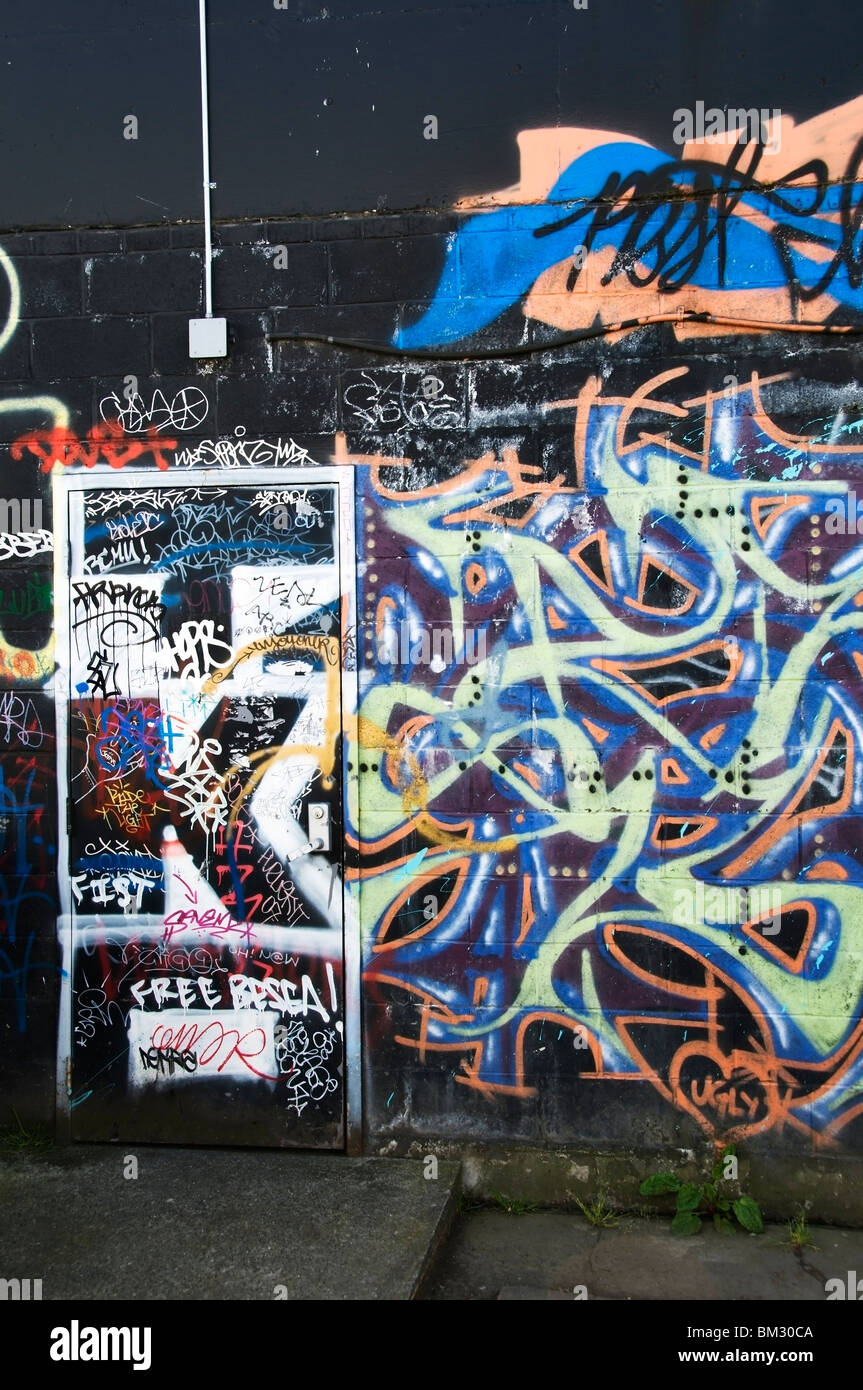 Graffiti on back of building in downtown Olympia, Washington. - Stock Image