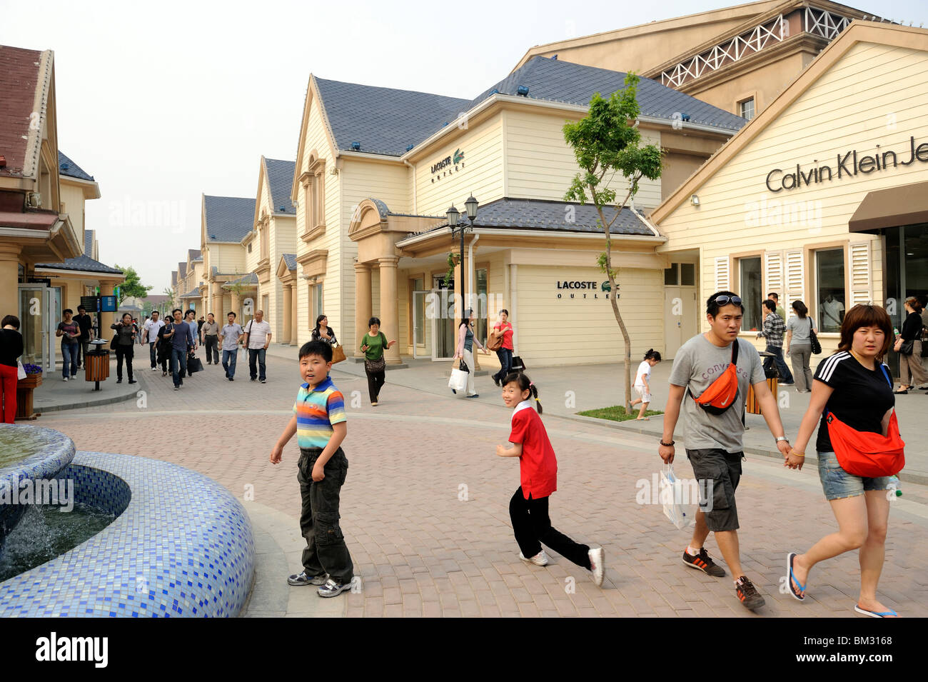7dce666c0 Chinese consumers walk at Beijing Scitech Premium Outlet Mall in Beijing