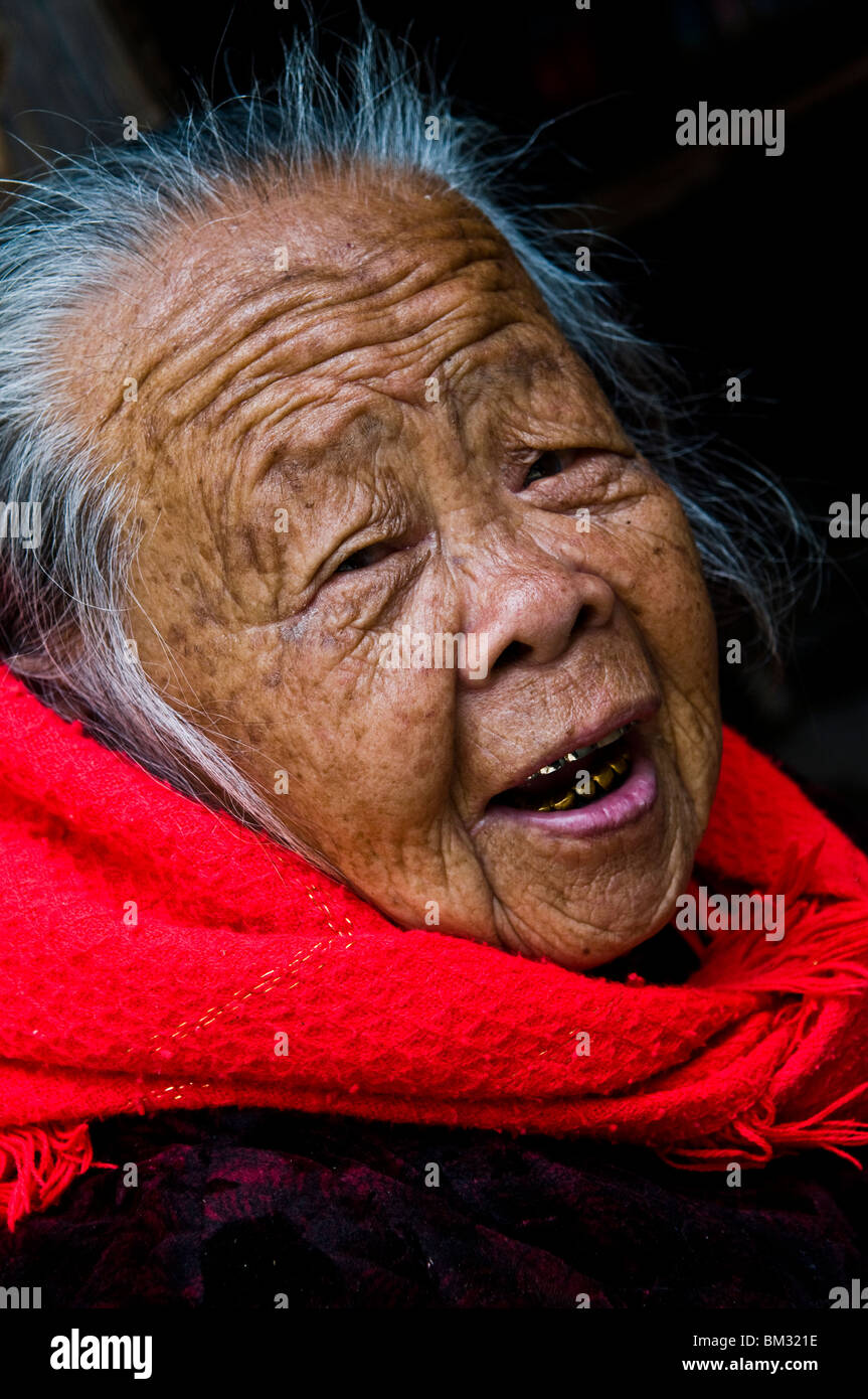 Portrait of an old lady taken in the old walled city of Chongwu, South China sea, China. - Stock Image