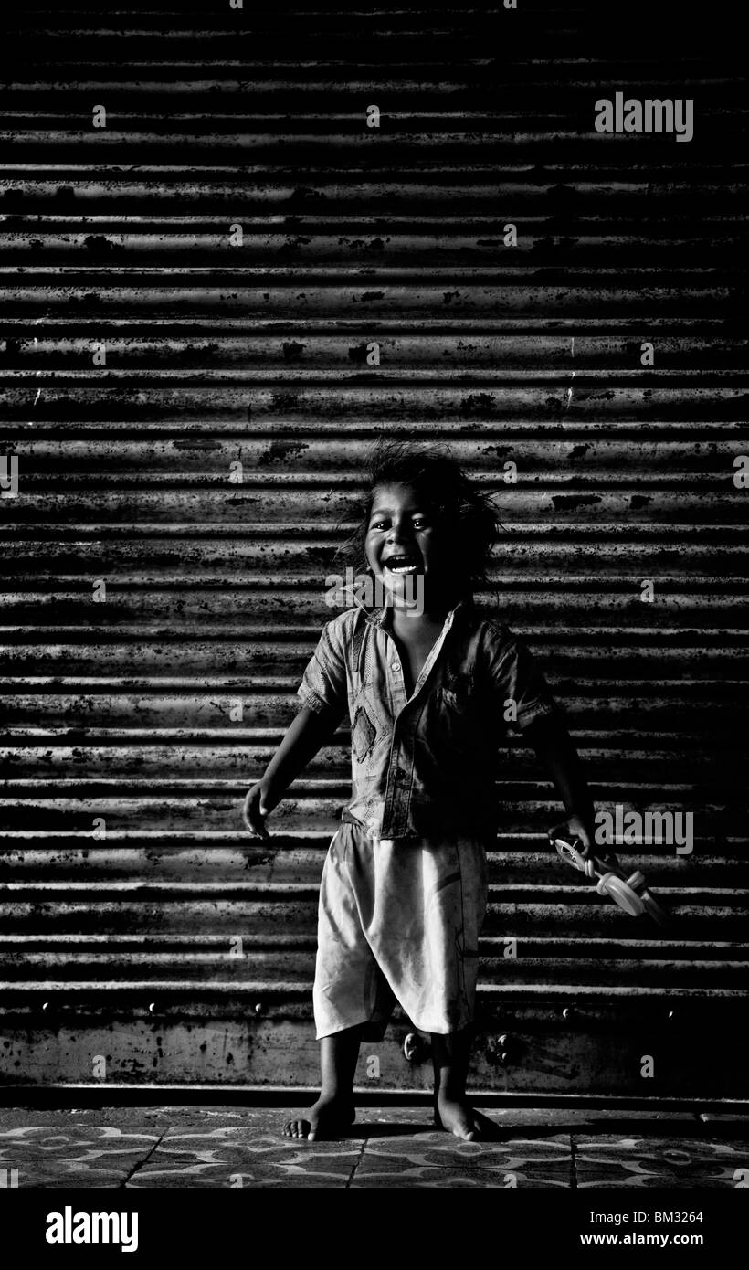 INDIA, MAY 12, 2010: A child laughs in the old town of Ahmedabad, Gujarat, India - Stock Image