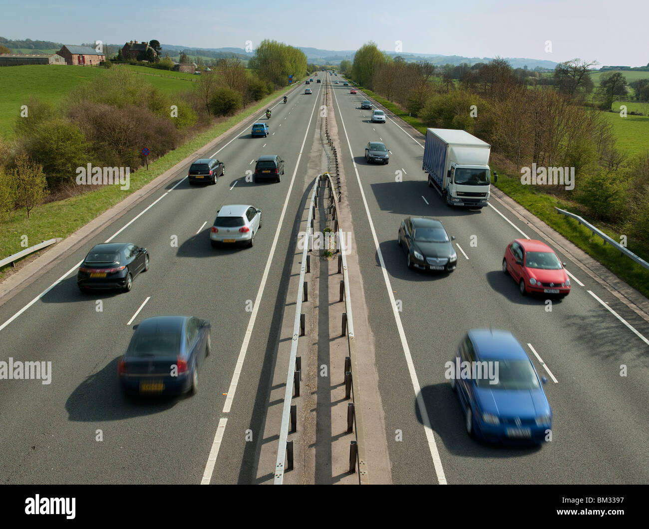 Busy dual carriageway with traffic in South Wales in spring viewed from bridge over dual carriageway - Stock Image