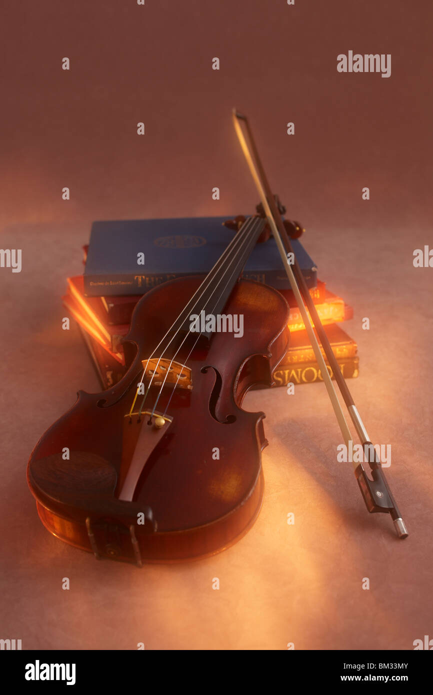 Violin and bow on books Stock Photo