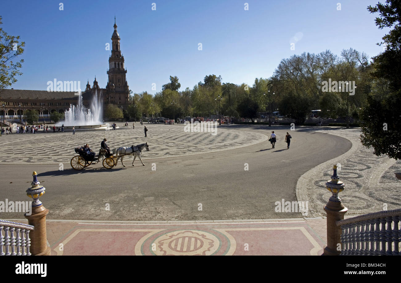 Tourists ride in a horse-drawn carriage in Plaza Spain in Seville, Spain, March 11, 2008. Photo/Chico Sanchez Stock Photo