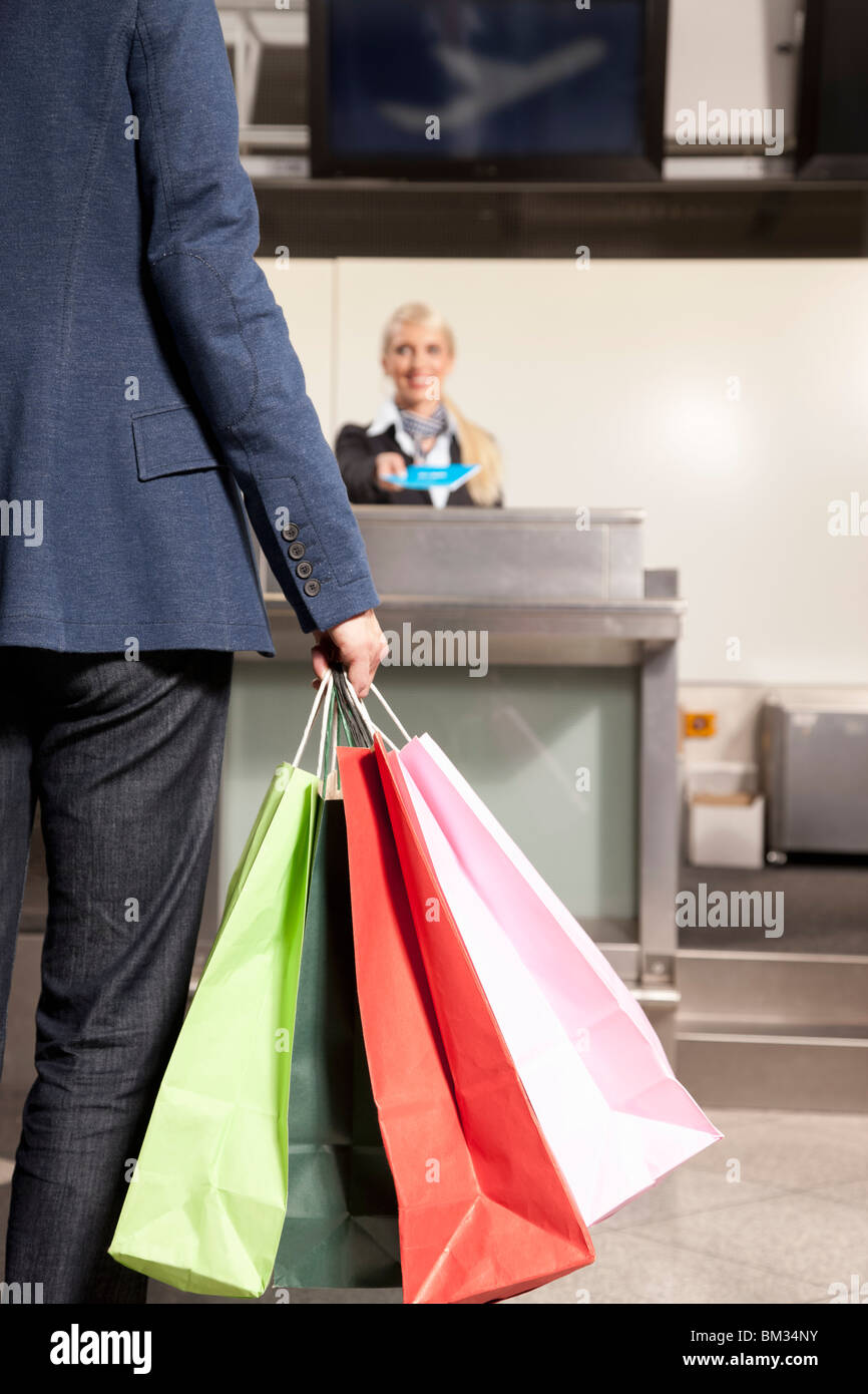 Woman with shopping bags traveling - Stock Image