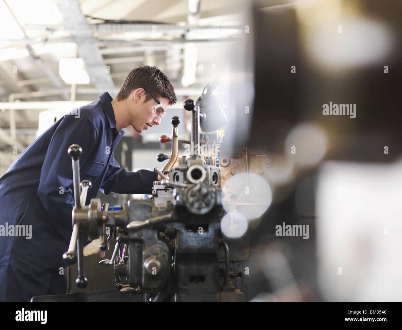 Apprentice Working With Basic Lathe - Stock Image