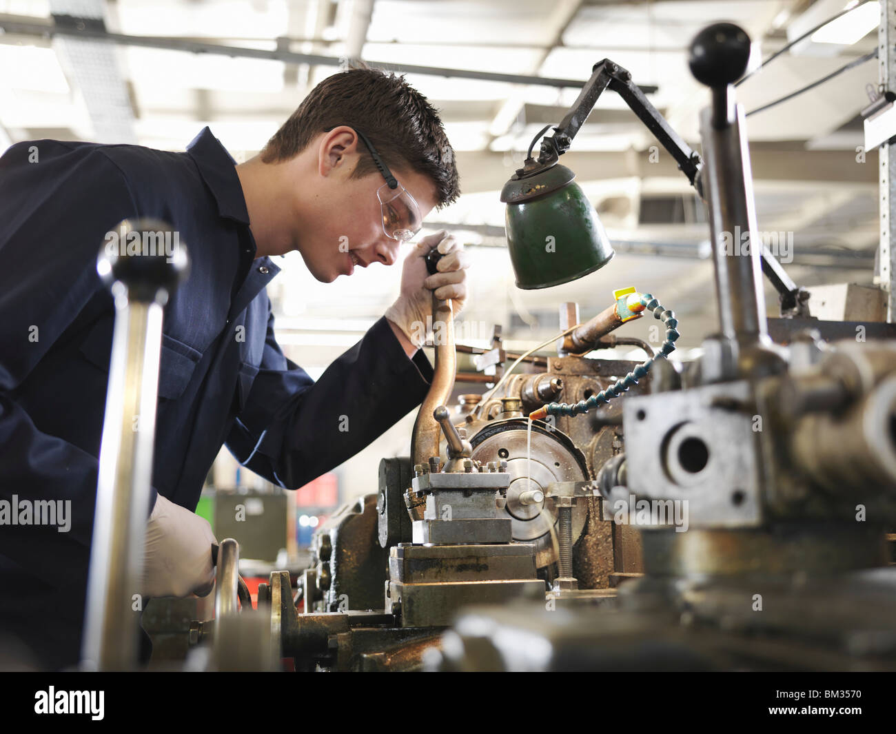 Apprentice Working With Basic Lathe - Stock Image