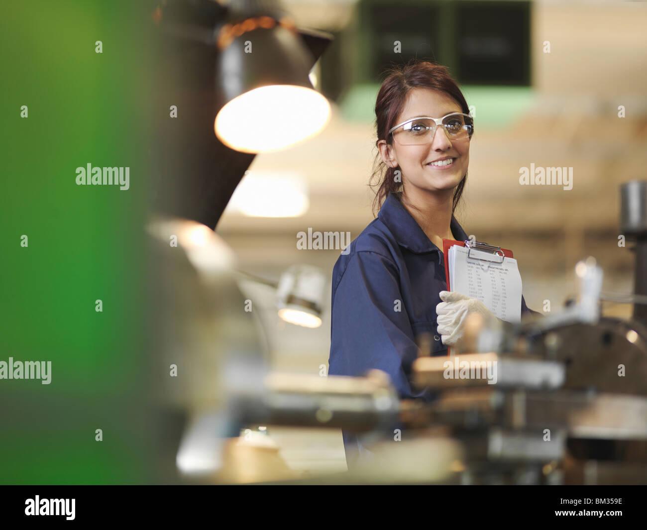 Female Apprentice With Clipboard Stock Photo