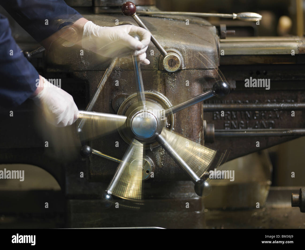 Hands Operating Lever On Machine - Stock Image