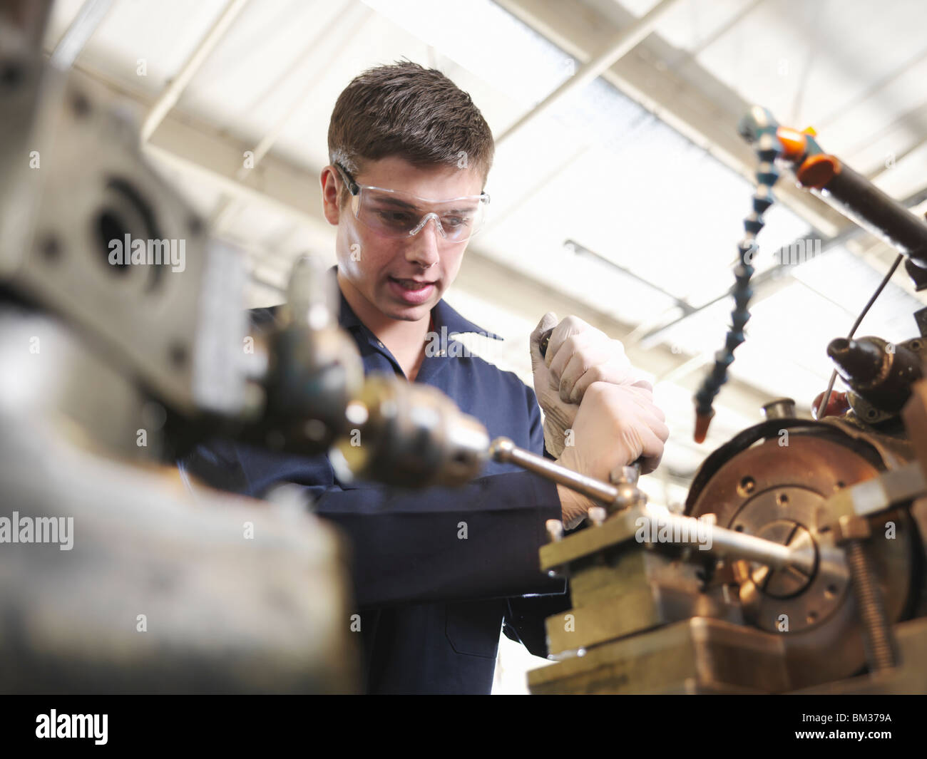 Apprentice Working With Lathe - Stock Image