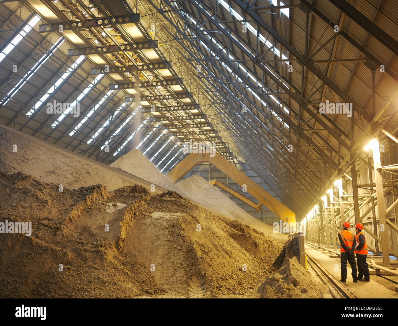 Workers Inspecting Gypsum Store - Stock Image