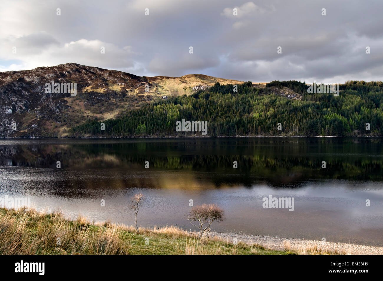 Loch more in the far north of Scotland in the Sutherland district taken from the A838 with reflection - Stock Image