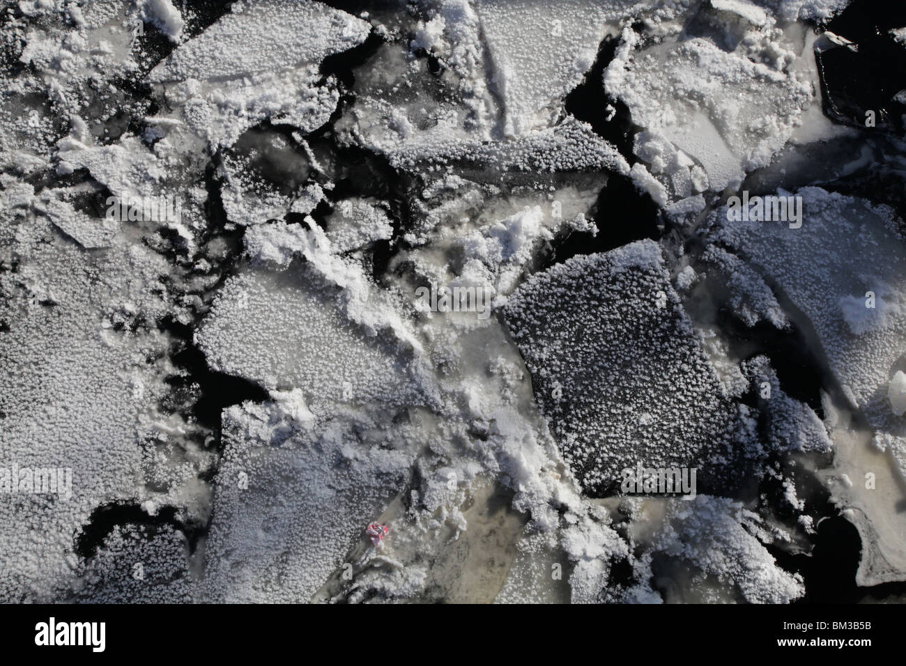 snow winter snow covered frozen ice float floating broken crack cracked close up close-up Kajaani Finland city centre Stock Photo