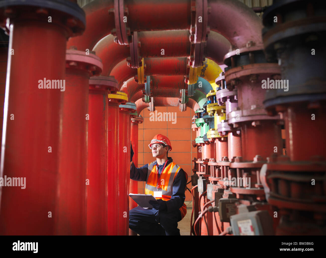 Worker In Coal Fired Power station - Stock Image