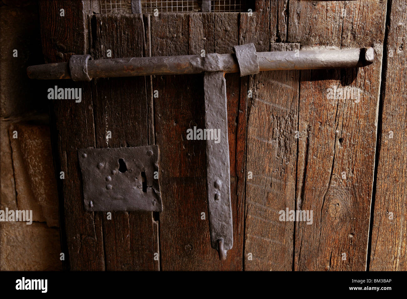 Old medieval lock on wooden castle door, real antique in Spain Stock ...