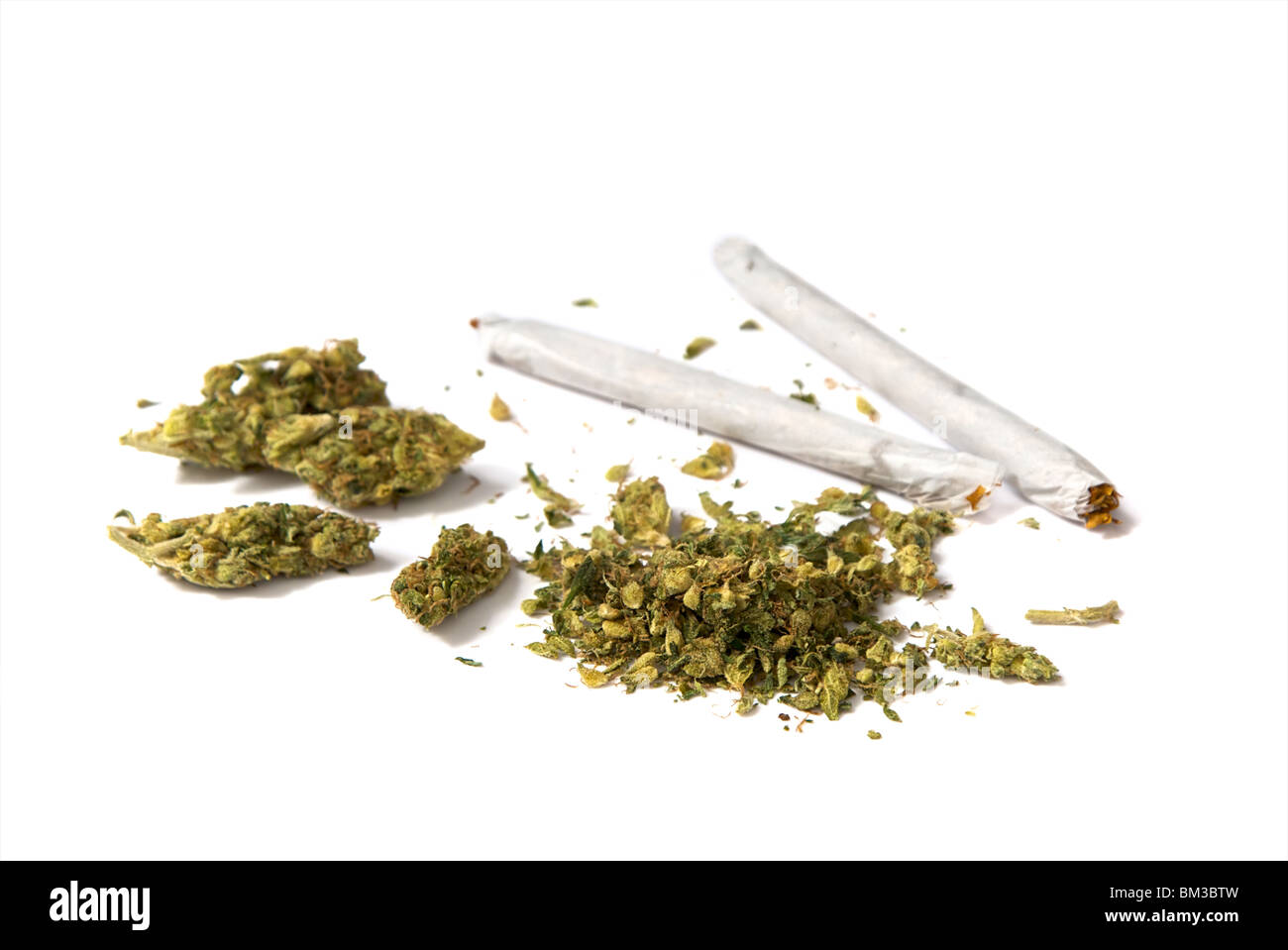 two joints and a stash of marijuana on white background - Stock Image